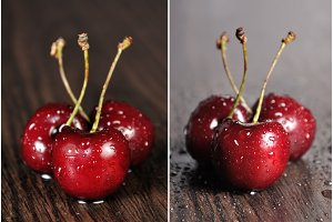 Cherries on wooden table with water