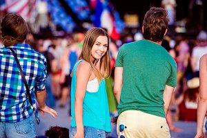 Teenagers at summer music festival having fun