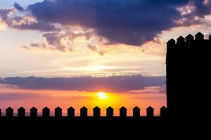 Silhouette of castle in sunset
