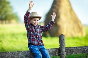 handsome little boy in hat