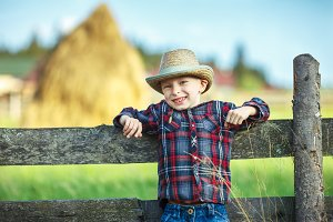 handsome little boy in hat