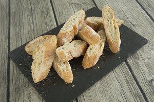 Bread on slate dish.