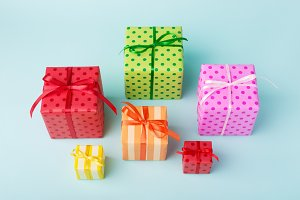 Colorful gift boxes on blue