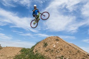 Young man flying on dirtjump bike