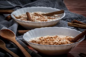 Cooked creamy rice pudding with cinn
