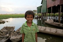 Young Boy in River Village