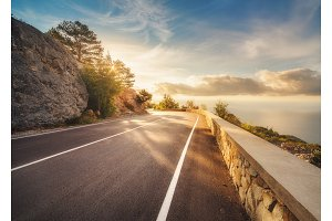 Mountain asphalt road at sunset in summer in Europe