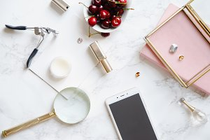 Flatlay mock up with mobile phone screen and feminine accessories