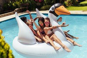 Girls having fun on floating toy