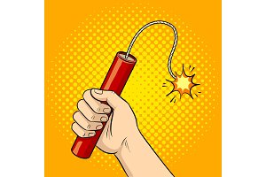 Hand with dynamite pop art vector illustration