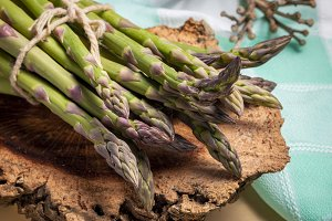 Green asparagus sprouts in rustic co