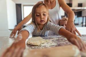 Little girl learning cooking