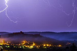 Thunderstorm over an old town