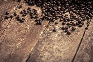 Coffee beans on wooden table backgro