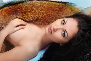 beautiful elegant woman with fur