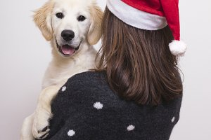 Christmas time. Woman with dog