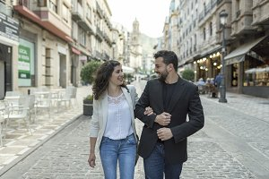 Couple walking and having fun walking in the street together