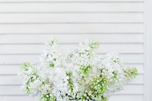 Bouquet of white lilac on the table