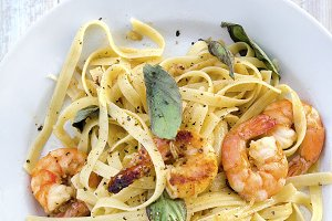 Pasta with prawns and basil leaves