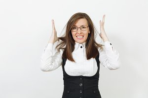 Shocked stress angry caucasian young brown-hair business woman in black suit, white shirt and glasses spreading hands isolated on white background. Manager or worker. Copy space for advertisement.