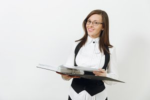 Beautiful happy caucasian young smiling brown-hair business woman in black suit, white shirt and glasses with folder with working documents isolated on white background. Copy space for advertisement.