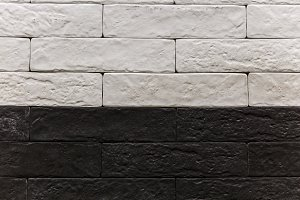 Stone wall brick texture background beige surface facade for design and decoration.