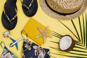 Travelers accessories on summer background