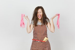 Young fun crazy dizzy loony wild screaming housewife tousled hair in striped apron squeegee cleaning rag in pocket isolated on white background. Mad woman and pink gloves. Copy space for advertisement