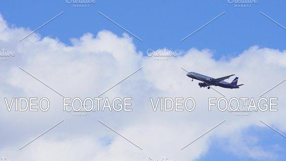 Flying Plane In Blue Sky