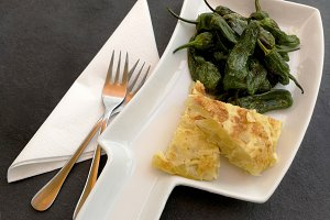 Spanish potato tortilla and peppers