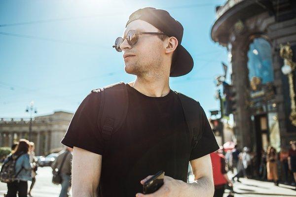 Handsome man tourist with phone. Yo…