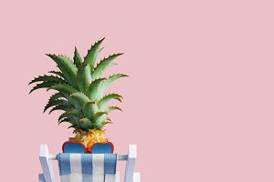 Pineapple on beach chair