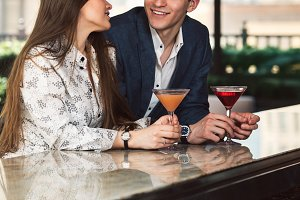Couple enjoy conversation drinks