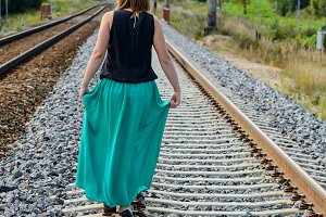 Young women walking on the rail track
