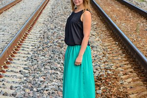 Standing girl between two railway path