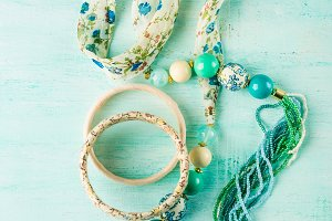 Girl's accessories on pastel background