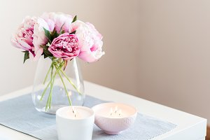 Pink peonies with candles