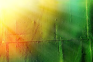 Vintage rusty metal plate texture with dramatic light leak background