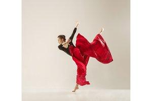 Modern ballet dancer dancing in full body on white studio background.