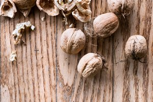 Walnuts on wooden background. Studio shot, copy space.