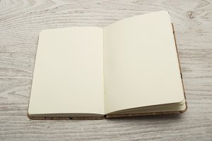 open notebook with blank sheets