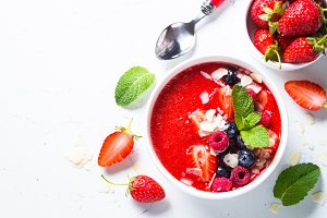 Smoothie bowl with fresh berries and almond.
