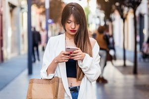 Woman buying and using mobile