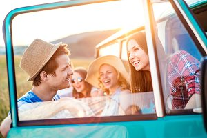 Group of teenage hipsters on a roadtrip, campervan