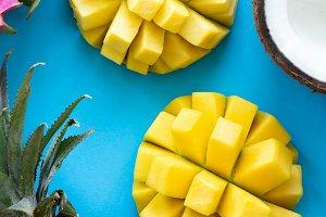 Fresh tropical fruits on blue
