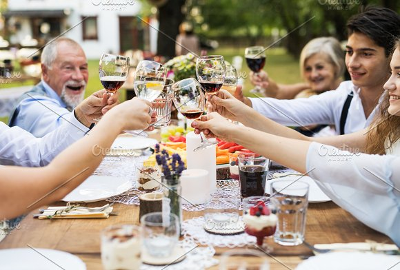 Garden Party Or Family Celebration Outside In The Backyard