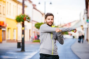 Young hipster man running in town, resting