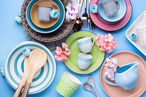 Tableware dish set on blue pastel background