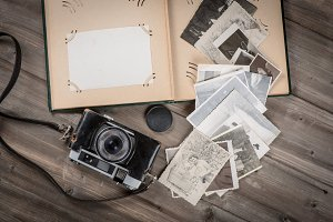 Old foto album with photos, camera.