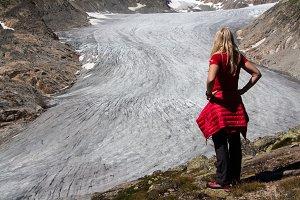 Traveler woman against Rhone glacier